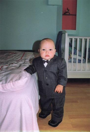 a little boy in the suit